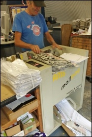 Mark Pickersgill packaging small paper orders for mailing - our print-shop has three full-timers: Mick Cotter, Martin Reynolds and Mark; our circulation manager is Chris Newby