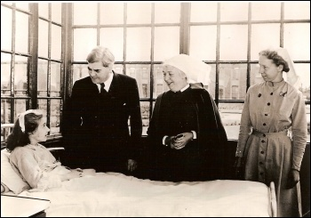 Labour's Nye Bevan speaking to one of the first patients to be cared for under the newly founded National Health Service. photo University of Liverpool/CC