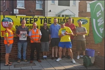 South Western rail workers on strike, joined by RMT president Sean Hoyle and Socialist Party members, 26.7.18, photo by Declan Clune