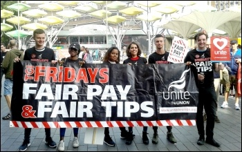 TGIFriday workers at Stratford, London. TGI staff at a number of restaurants have been on strike against cuts in their tips. photo by Pete Mason