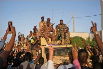 Workers fraternised with soldiers when hardliners in Sudan were preparing a crackdown in April, photo M Saleh/CC