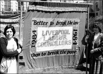 Pauline Dunlop (left) with the Liverpool 47 councillors' banner, photo Militant