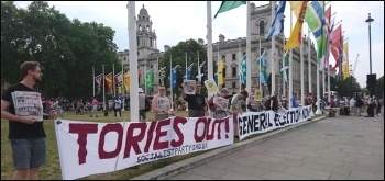 Socialist Party members protesting outside parliament against Boris Johnson, photo S. Stanicic