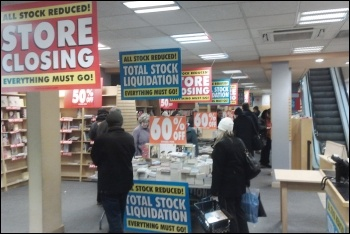 Retail bosses are taking out reduced profits on their workers, photo by fsse8info/CC
