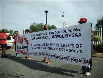 Our banner on the workers' demonstration, photo Marxist Workers' Party