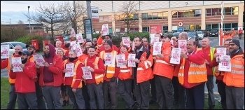 Royal Mail workers in the Communication Workers' Union (CWU) at a gate meeting leicester Meridian, photo by Steve Score