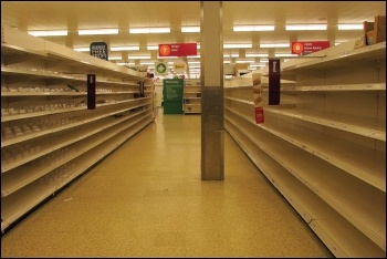 Shelves cleared by profit-hungry supermarkets permitting uncontrolled panic buying, photo Derek Harper/CC