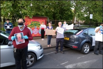 Protesting against Covid deaths and Labour council cuts in Newham, photo by Dave Carr