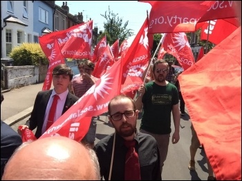 Flying the red flag at Ken Douglas' funeral June 2020, photo Niall Mulholland