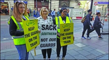 Train guards in RMT union took strike action in 2007 to defend the role of guards on trains from attacks by bosses. photo: Rob Williams