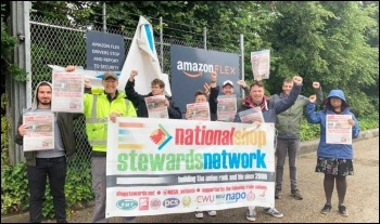 Protesting in Enfield, London, in support of electricians sacked by contractor SIS Systems at Amazon's warehouse under construction at Follingsby Park, Gateshead. 21.6.21