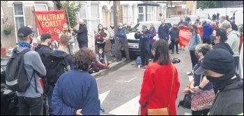 Protesters gather to see of the baliffs. Photo: Martin Reynolds