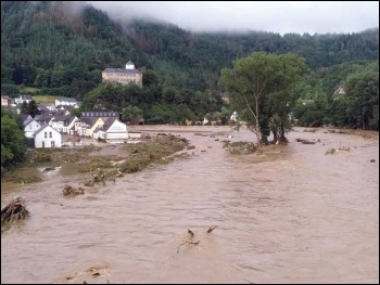 The flooded River Ahr in Altenahr, Germany. Such extreme weather events are becoming the norm under capitalism