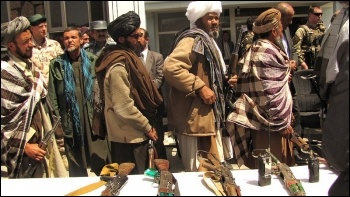Former Taliban fighters return their weapons 2012. Photo: isafmedia/CC