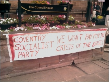 Coventry Socialist Party councillor Dave Nellist addresses a Coventry Against the Cuts protest, photo Coventry Socialist Party
