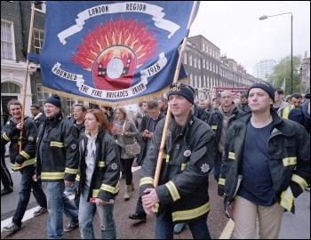 100 striking FBU firefighters led the London October 23rd trade union led demonstration against the cuts, photo Paul Mattsson