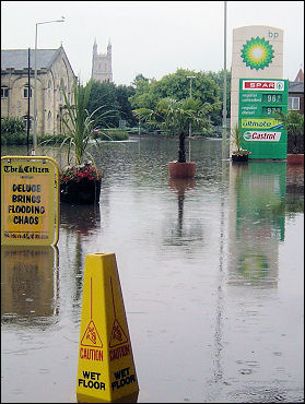 Caution wet floor - flooding in the centre of Gloucester, photo Chris Moore