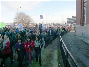 Over 1,400 students from Holy Cross sixth form college and Bury College walked out and marched to a huge rally outside Bury town hall, photo by Paul Gerrard