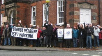 Around 100 people gathered outside the offices in Knutsford, Cheshire where George Osborne is the MP, photo by Hugh Caffrey