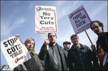 Thousands of workers, students and anti-cuts campaigners marched through Cardiff on Saturday 5 March to tell visiting Con Dems we don't accept your cuts, photo by Paul Mattsson