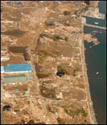 Japan: earthquake and tsunami: an aerial view of tsunami damage in Tōhoku, photo from Wikipedia