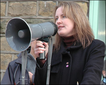 Jackie Grunsell, TUSC candidate, GP and councillor, speaks at a Save Huddersfield NHS demonstration, photo Huddersfield SP
