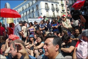 Madrid: Spain's town squares filled with tens of thousands of indignados (angry people), mainly youth, in protest at the anti-social consensus of both PSOE and the PP , photo Sarah Wrack