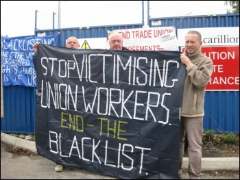 Manchester electricians protesting on 31.8.11 as part of protests around the country against the employers' assault on pay and conditions. From left to right, Simon, Steve and Sean leafleted outside the Carillion site in Denton, Manchester, photo Hugh C
