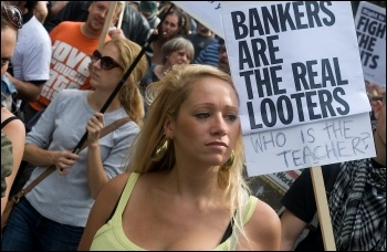 Bankers are the real looters: placard on Hackney - Tottenham demo after the riots , photo by Paul Mattsson