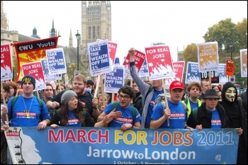 Youth Fight for Jobs on the Jarrow march, in London marching past Parliament, photo by Sarah Wrack