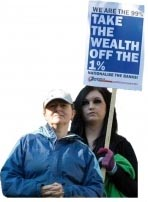 We are the 99% - Take the wealth off the 1% - Socialist Party placard, photo by Paul Mattsson