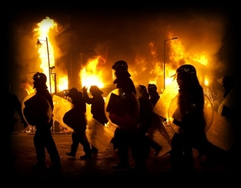 Riots: rioters and police in Tottenham during August 2011 disturbances , photo by Paul Mattsson