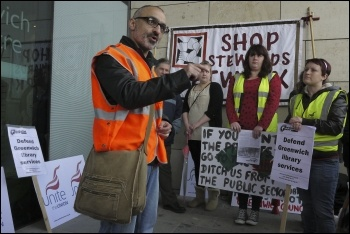 Onay Kasab speaking to Greenwich library workers and supporters against privatisation, 27.4.12, photo by Paul Mattsson