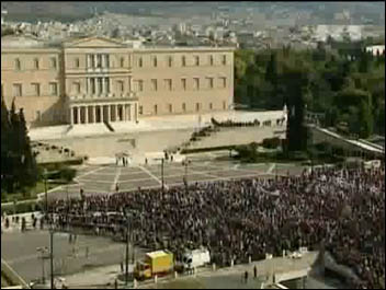 Protesters clash with police outside the Greek parliament October 2011, photo by RT free video